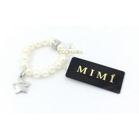 Elastischer Mimì Ring mit weißen Perlen und Stella Anhänger