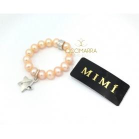 Elastischer Mimì Ring mit cremefarbenen Perlen und Stella Anhänger
